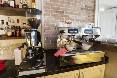 espresso machine: Coffee maker and espresso machine at restaurant counter