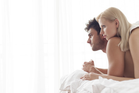 romance bed: Thoughtful young couple in bed