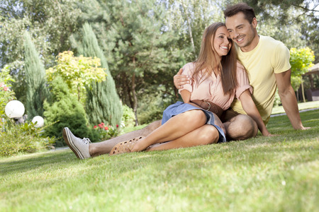 spending full: Full length of smiling young couple spending time together in park