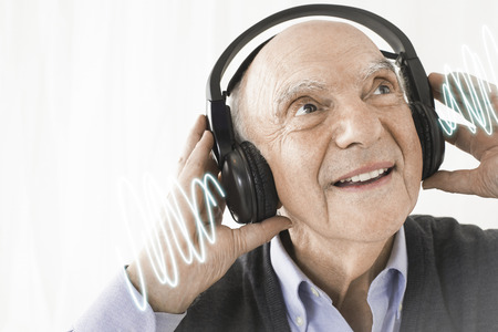 70s adult: Man Listening to Music