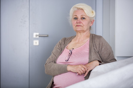 czech women: Portrait of confident senior woman sitting in house