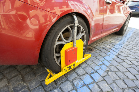 clamped: Car clamped on cobbled street