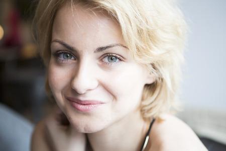 czech women: Close-up portrait of confident woman in cafe LANG_EVOIMAGES