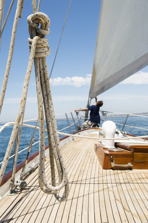 prow: Man working on prow of yacht