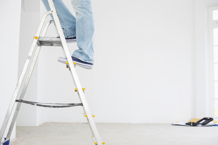 home improvement: Low section of man on ladder