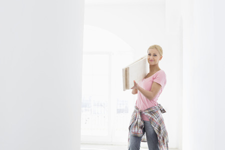 shoulder carrying: Woman carrying wooden planks on shoulder