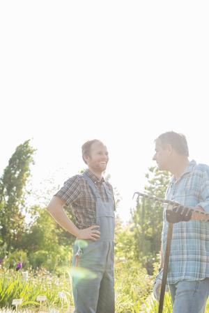 plant nursery: Happy gardeners conversing at plant nursery