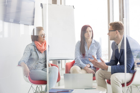 business casual: Business people discussing in meeting room