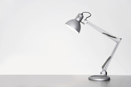 desk lamp: Desk lamp on table over white background LANG_EVOIMAGES