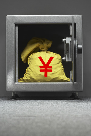 yen sign: Bag of money with yen sign in open locker