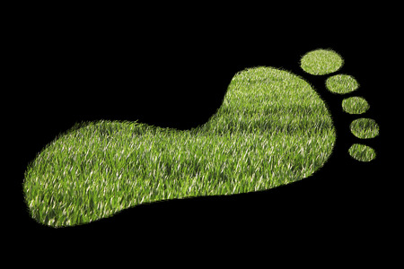 carbon footprint: Close-up of green footprint over black background