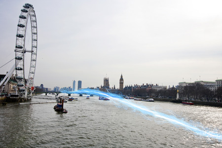 passing over: Blue streak of light passing over river Thames