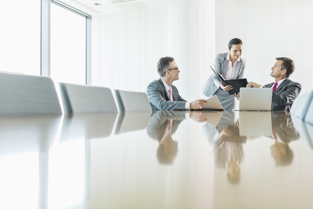 conference room table: Business people in meeting