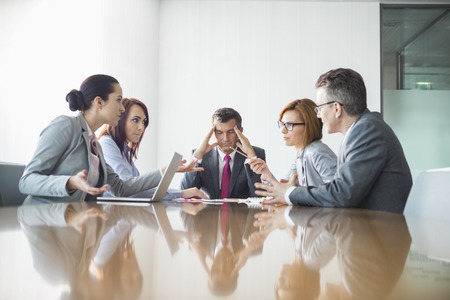 conference room table: Businesspeople arguing in meeting