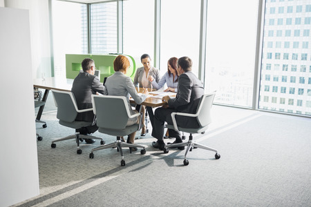 conference room table: Businesspeople in conference room