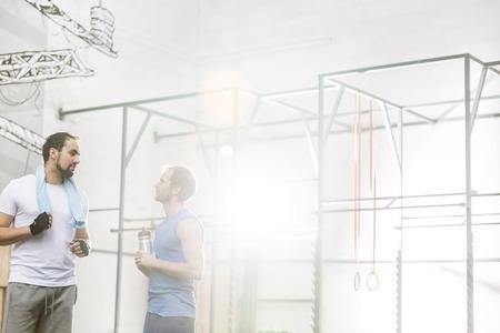 conversing: Men conversing in crossfit gym LANG_EVOIMAGES