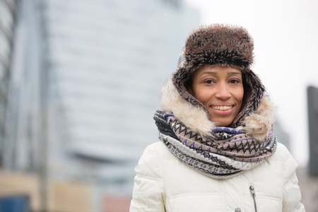 warm clothing: Portrait of happy woman in warm clothing outdoors LANG_EVOIMAGES