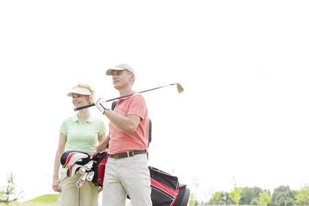 ���clear sky���: Low angle view of smiling golfers standing against clear sky