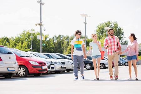 4 people: Happy friends walking on city street