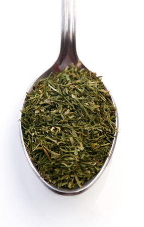 herbs de provence: Dried rosemary on spoon - studio shot