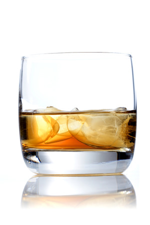 shot glass: Glass of whisky on white background LANG_EVOIMAGES