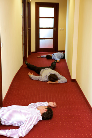 three people only: Three businessman lying down in office