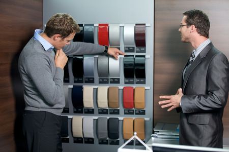 salesperson: Salesperson showing color swatch to customer