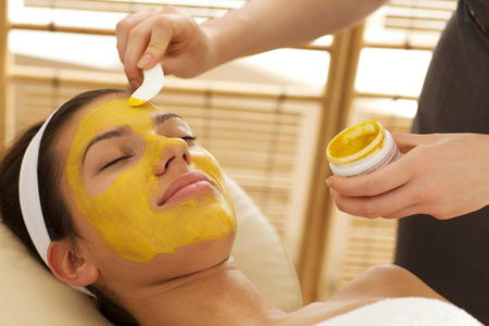 beauty parlor: Close-up of young woman having facial mask in beauty parlor