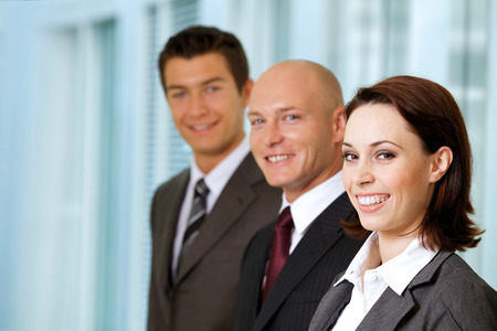 three people only: Portrait of young caucasian business people in office