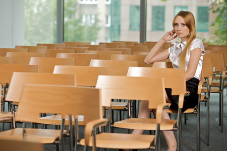lost in thought: Businesswoman contemplating at conference room in office