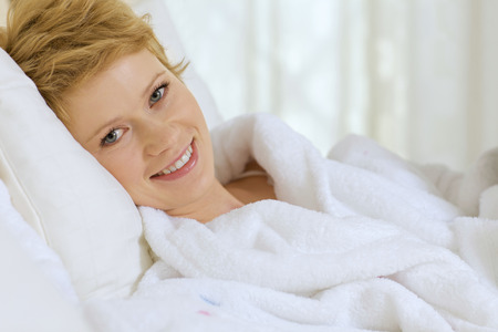 rested: young woman  in bed