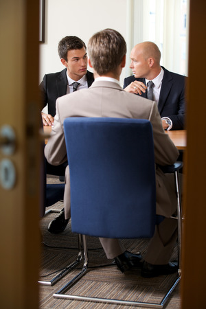 only mid adult men: Businessmen in meeting at board room