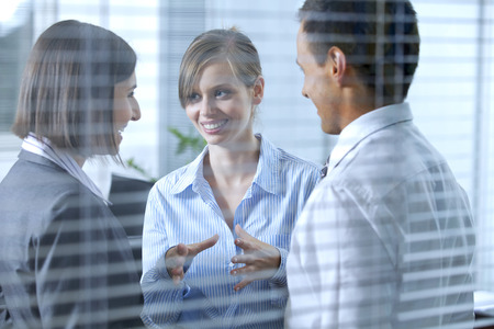 conversation: Business people conversing in office