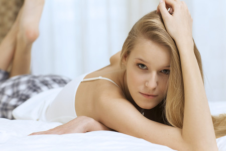 only 1 person: young woman lying in bed