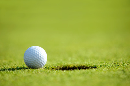 recreational pursuits: Golf ball near hole