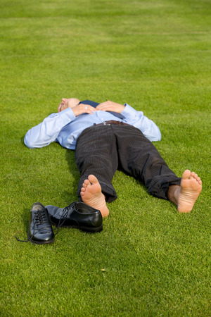 formals: Businessman relaxing in park