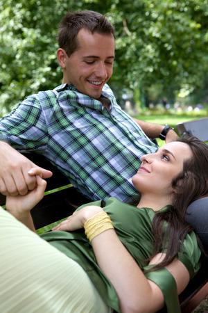 only two people: Girlfriend resting head on boyfriends lap