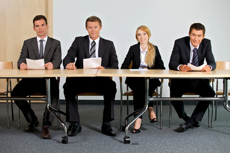 four person only: Portrait of business people sitting in office LANG_EVOIMAGES