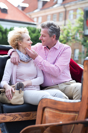 horse cart: Romantic middle-aged couple sitting in horse cart
