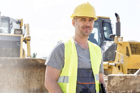 supervisor: Portrait of confident supervisor standing at construction site LANG_EVOIMAGES