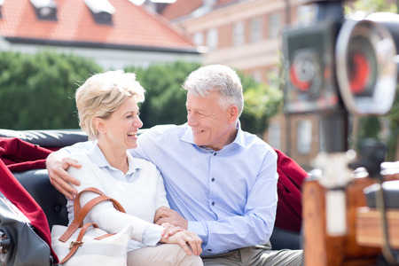 middleaged: Romantic middle-aged couple sitting in horse cart
