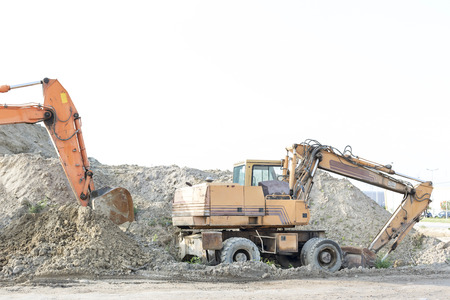 bulldozers: Bulldozers on construction site against clear sky