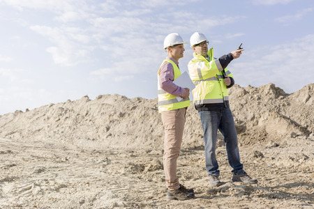 Supervisor examining construction site against sky Stock Photo