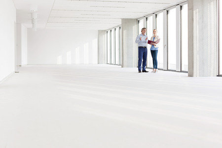 mid distance: Distant image of business people discussing in empty office