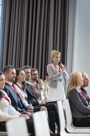 Convention Center: Businesswoman asking questions during seminar in convention center