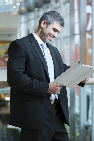 business: Businessman reading document