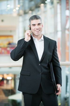 business: Businessman talking on mobile phone