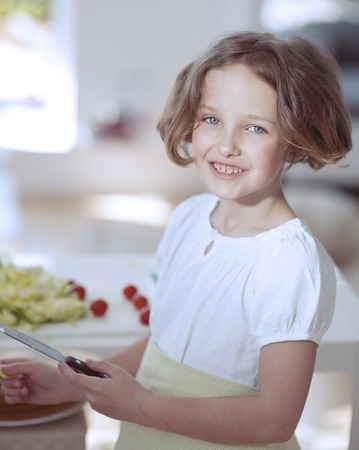 Young girl holding knife in kitchen