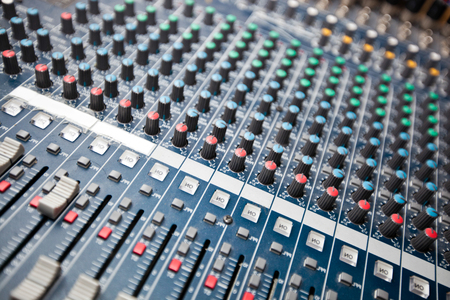 Close-up of sound mixing equipment in studio