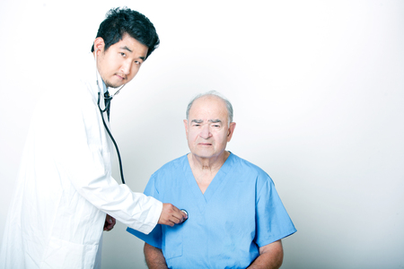 A young Asian Doctor comforting a Senior adult patient